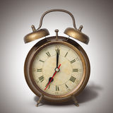 Brown old style alarm clock with shadow Royalty Free Stock Photos