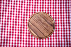 Brown old vintage wooden table with framed red checkered tablecloth and pizza cutting board.Thanksgiving day and Cristmas table royalty free stock images