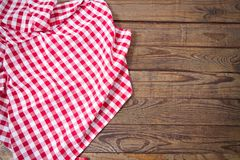Brown old vintage wooden table with framed red checkered tablecloth. Thanksgiving day and Cristmas table concept. Top view. stock images