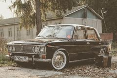 Brown Oldtimer in the village VAZ 2103 with white wall wheels royalty free stock image