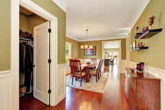 Brown and olive tones dining room interior Stock Photos