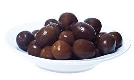Brown  olives in bowl isolated. On white background Royalty Free Stock Photos
