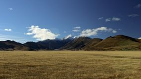 Brown Open Field With Mountain Range during Daytime Stock Photography
