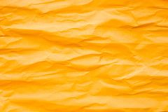 Brown orange crumpled paper. For background royalty free stock images