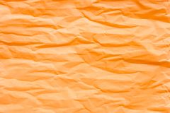 Brown orange crumpled paper. For background royalty free stock photo