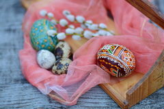 Brown and orange easter egg with traditional ormanent. On foreground Stock Photo