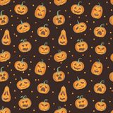 Brown and orange halloween pattern with carved pumpkins. Halloween pattern with carved pumpkins with different emotions. Vector seamless brown and orange pattern vector illustration