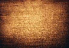 Brown, orange scratched wooden cutting board. Royalty Free Stock Images