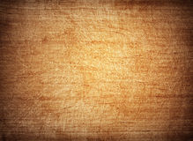 Brown, orange scratched wooden cutting board. Royalty Free Stock Photography