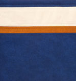 Brown/orange, white and blue leather Stock Photos