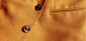Brown-orange woolen Mantelabschluß oben lizenzfreie stockfotografie