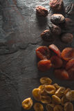 Brown, orange, yellow dried apricots on a gray stone Stock Image