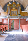 Brown organ with pipes of lead. Royalty Free Stock Photography