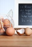 Brown organic eggs with recipe in kitchen Royalty Free Stock Photo