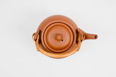 Brown oriental teapot on white background Stock Photo