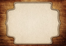 Brown ornate paper frame on old scratched cutting Royalty Free Stock Images