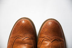 Brown oxford classic leather waxed fine stylish elegant male shoes closeup. Brown oxford classic leather waxed fine stylish elegant male shoes Stock Photography