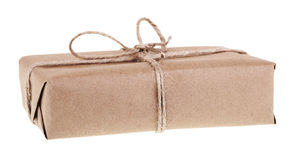 Brown Package Isolated. Package wrapped in brown paper and string isolated on white stock image