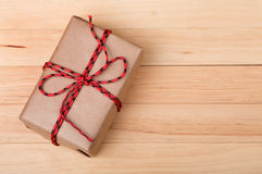 Brown Package on Wood Background Stock Photo