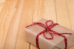 Brown Package on Wood Background Stock Images
