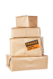 Brown packages. Stack of brown packages isolated on white background. Shallow depth of field Stock Image