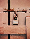 Brown padlock on hardwood door Stock Images