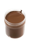 Brown paint. Brown gouache paint in a jar on white Stock Image