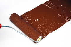 Brown paint roller Stock Photo