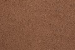 Brown painted stucco wall. Royalty Free Stock Images