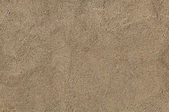 Brown painted stucco wall. Stock Photo