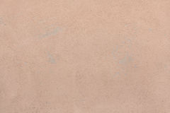 Brown painted stucco wall. Background texture Royalty Free Stock Images