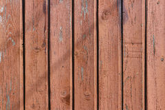 Brown painted and weathered shabby wooden planks. Natural wood texture Royalty Free Stock Images