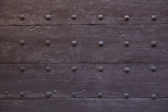 Brown painted wooden gate fixed with rivets. Background texture Stock Image
