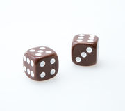 Brown pair of dice Royalty Free Stock Images