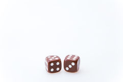 Brown pair of dice Stock Photo