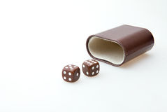 Brown pair of dice Stock Image