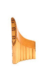 Brown pan flute. With decorations isolated on white Royalty Free Stock Photos