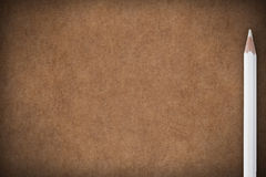 Brown paper background with white crayon Royalty Free Stock Photos