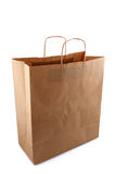 Brown paper bag. Empty brown paper bag isolated over white Stock Photography