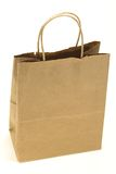 Brown paper bag. Old brown paper bag isolated against a white background Stock Photos