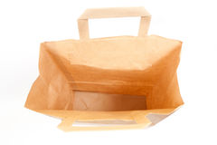 Brown Paper Bag. With handles, isolated on white background Stock Image
