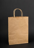 Brown paper bag  on a black Stock Photos
