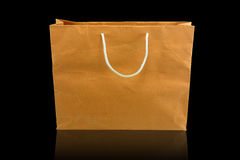 Brown paper bag on black background Royalty Free Stock Image