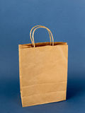 Brown paper bag  on a blue Royalty Free Stock Image