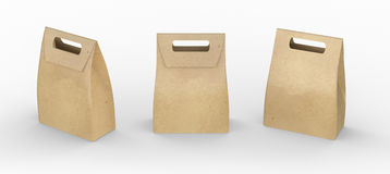 Brown paper bag folded  package with handle, clipping path inclu. Ded, template for your design or artwork Royalty Free Stock Images