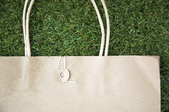 Brown paper bag. On grass background Royalty Free Stock Photos