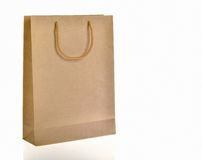 Brown paper bag. With handle Stock Photography