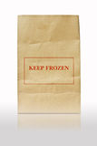 Brown paper bag with keep frozen sign Stock Images
