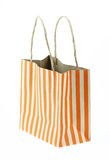 Brown paper bag orange stripes isolated on white Royalty Free Stock Images