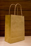 Brown paper bag on table Stock Image